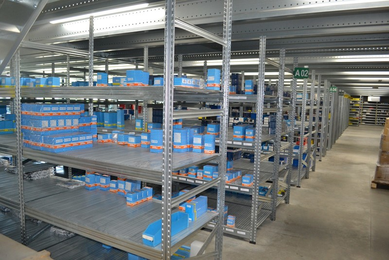 Shelving under industrial mezzanine floor